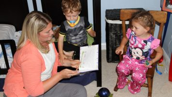 Mary Dumek reads a bedtime story to her two young children. A new study from The Ohio State University College of Public Health shows that preschoolers who go to bed at 9 pm or later are twice as likely to be obese as teenagers, compared to those who go to bed at 8 pm or earlier.