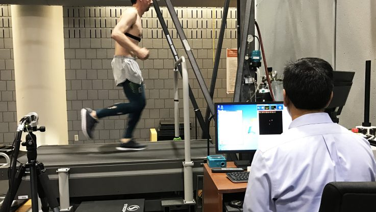 Ajit Chaudhari, PhD, FACSM, monitors a runner using motion sensor technology to study the effects of compression tights on muscle vibration and fatigue.