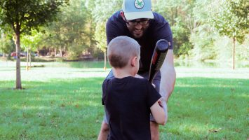 Matt Hurt shows his five-year-old son how to swing a baseball bat. A new study suggests that fathers can give their children a genetic head start on a healthy metabolism by exercising prior to conception.